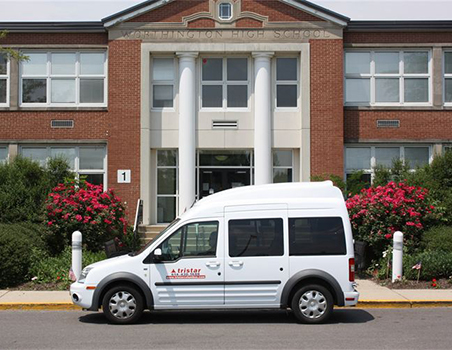 Tristar van in front of school building